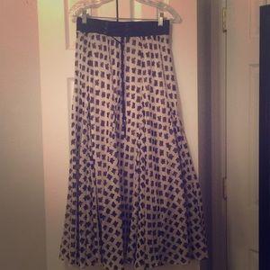 Flowy black and white floor length skirt.